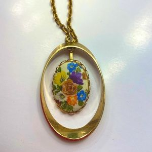 Antique floral necklace on gold chain.